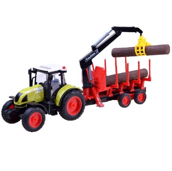 Dětský traktor s vlečkou a kmeny stromů